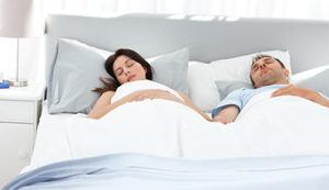 couple in bed - what is sleep-talking? Galligans Adelaide.